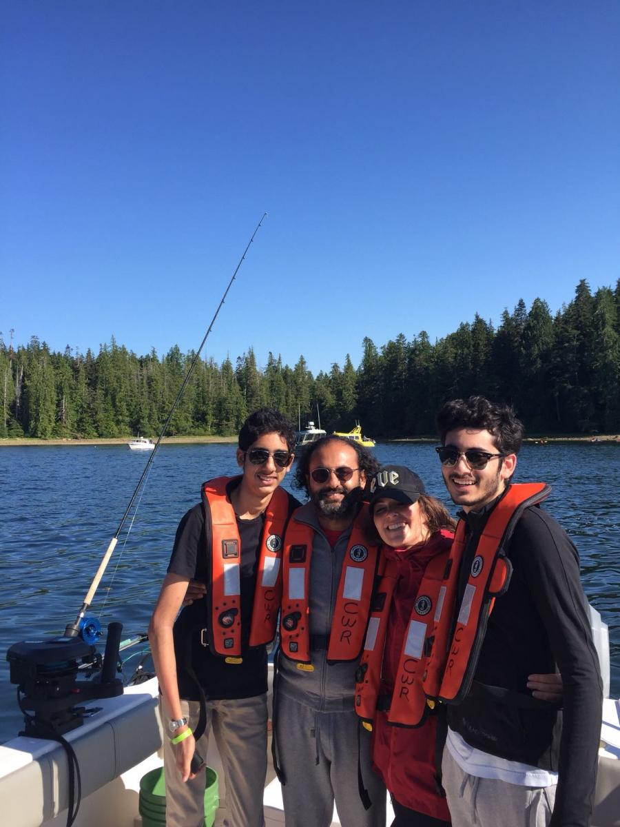 Feisal Alibhai (second from left) at Clayoquot Wilderness Resort, Canada with his younger son Kazim (far left), his beloved Suz (second from right) and older son Mahdi (right)